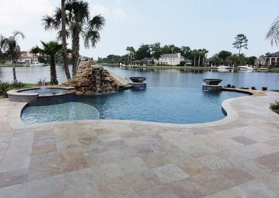 CLASSICO TRAVERTINE TILES AROUND A SWIMMING POOL