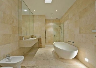 Honed and filled travertine bathroom tiles