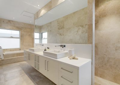 Ivory travertine bathroom floor and wall tiles