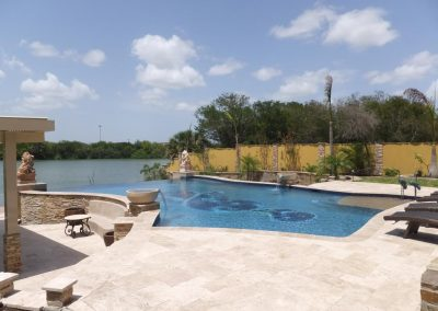 Ivory travertine pool coping tiles and non slip paving