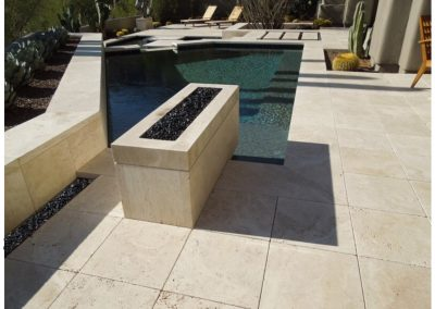 TRAVERTINE TILES AROUND A SWIMMING POOL (2)
