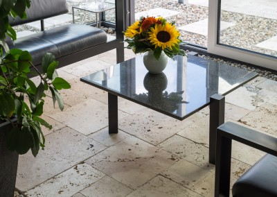 Unfilled and tumbled travertine tiles