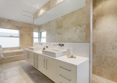 Ivory travertine bathroom floor and wall tiles