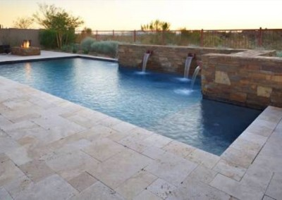 Travertine tiles around a swimming pool